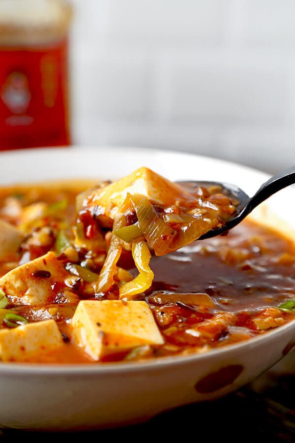 Vegan Mapo Tofu Recipe - Make this mapo tofu at home and never order it again! Mushrooms make this vegan mapo tofu recipe tastier and healthier than the ground meat version. Plus, they crank the level of umami up to 11! tofu recipe| Chinese food recipe | Szechuan Food | spicy tofu recipe | Asian Food Recipes | pickledplum.com