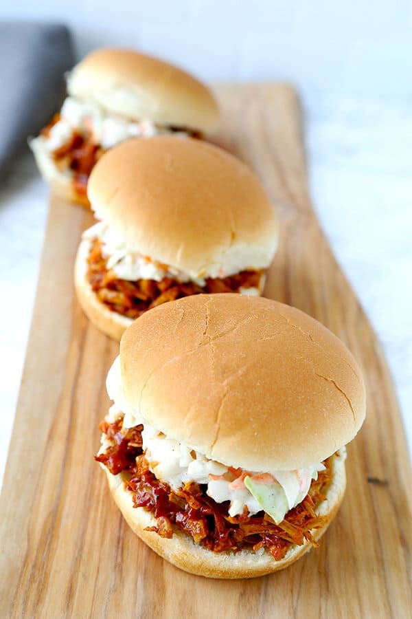 Vegan Jackfruit Pulled Pork Sandwiches - Skip the meat, extra fat and calories with a dreamy barbecue pulled jackfruit sandwich. This smoky, sweet and tangy sandwich is proof that plant based food can be just as delicious as the real thing! plant based recipes, vegan sandwich recipes, healthy vegan recipes, healthy super bowl recipes | pickledplum.com