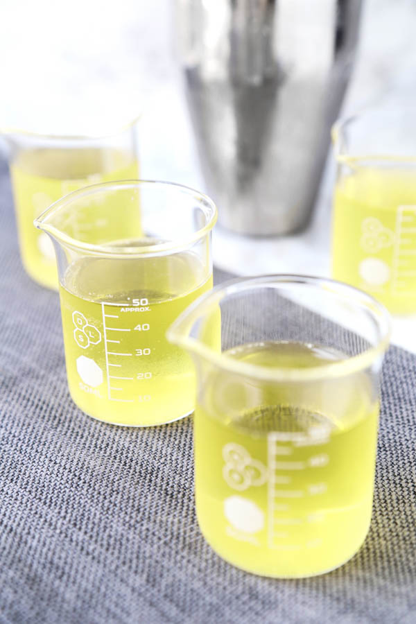 Green Tea Shot - This tasty cocktail gets its name from its kinda greenish color - no green tea is actually used in this shot recipe. What you get are bright and soothing peachy flavors. Cocktail recipes, shots alcohol, shot recipes, alcoholic drinks for a party, alcohol and spirits | pickledplum.com