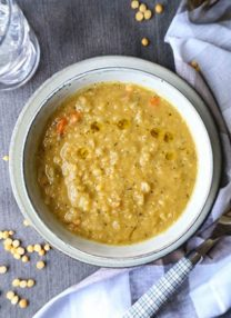 Vegetarian Split Pea Soup Recipe - This is a healthy and comforting vegetarian split pea soup recipe. Learn how to make it on a stove top or in a slow cooker with just 10 ingredients! #vegansplitpeasoup #healthyrecipes #meatless #glutenfree | pickledplum.com