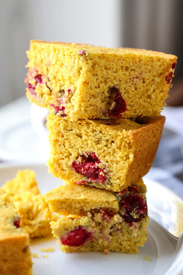 Gluten Free Cornbread with Cranberries - This fruity Gluten Free Cornbread recipe is moist, sweet and so addictive! I always make doubles when I serve this because it tastes so much better than just regular cornbread! #thanksgivingrecipes #cornbreadrecipe #holidaycooking| pickledplum.com