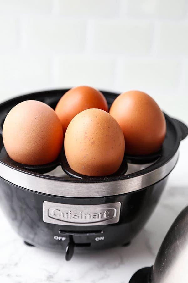 Eggs in the tray of an egg cooker.