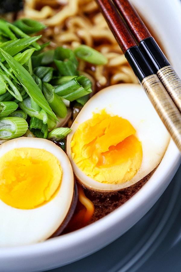 Ramen egg in bowl of ramen.