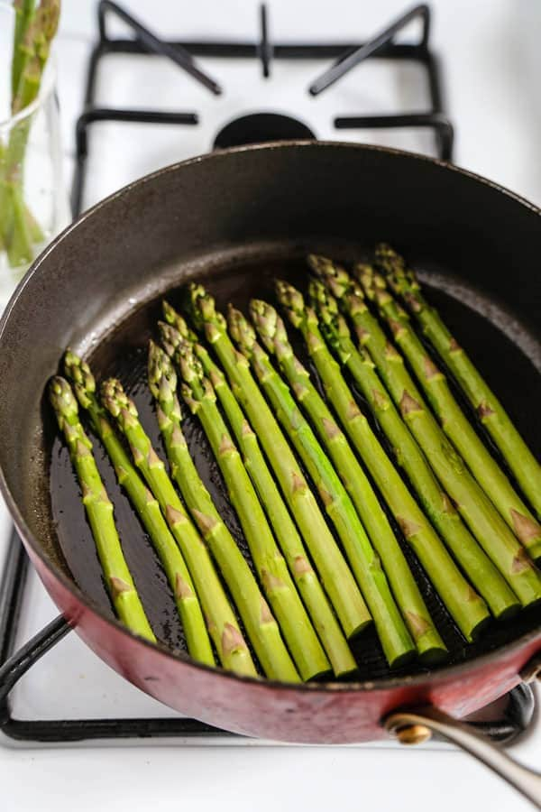 sauteeing asparagus in the pan