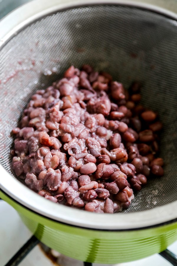 Red Bean Paste (Anko) - If you are a fan of Japanese desserts then you are most likely a fan of red bean paste! Used in East Asian cuisines, red bean paste, or anko (餡子) has a sweet flavor similar to sweet potatoes and a chewy, almost creamy texture. Only two ingredients are needed to make red bean paste - sugar and azuki beans. This is an easy recipe for tsubuan anko. #japanesefood #japanesedessert #adzukibeans | pickledplum.com