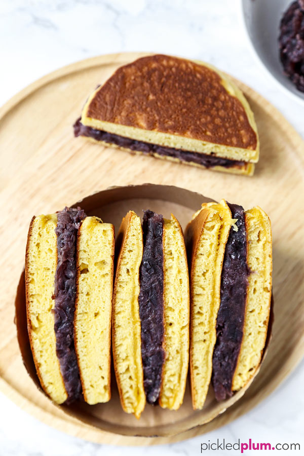 Dorayaki (Japanese pancakes with red bean paste) - This is a recipe for a traditional Japanese confection ((和菓子, wa-gashi)) called dorayaki. Dorayaki is a delicious sandwich-like treat made with two pancakes and filled with red bean paste. It's loved by kids and adults all across Japan. And by Doraemon too! #japaneserecipe #dessertrecipe #pancakes #japanesesweets | pickledplum.com