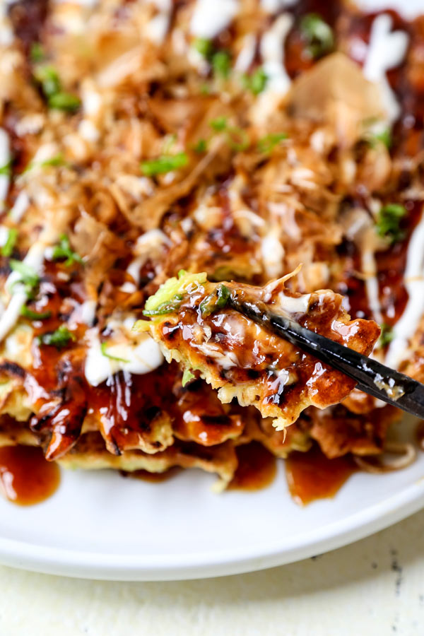 Okonomiyaki Recipe - Sometimes called Japanese pizza, Okonomiyaki お好み焼き means 'grilled how you like it'. Introduce your kids to cabbage with this yummy and easy Okonomiyaki Recipe. Ready in just 20 minutes from start to finish! Osaka style recipe, vegetarian okonomiyaki, easy with okonomi sauce, simple and healthy. #okonomiyaki #japanesepancake #healthyeating #japanesefood | pickledplum.com