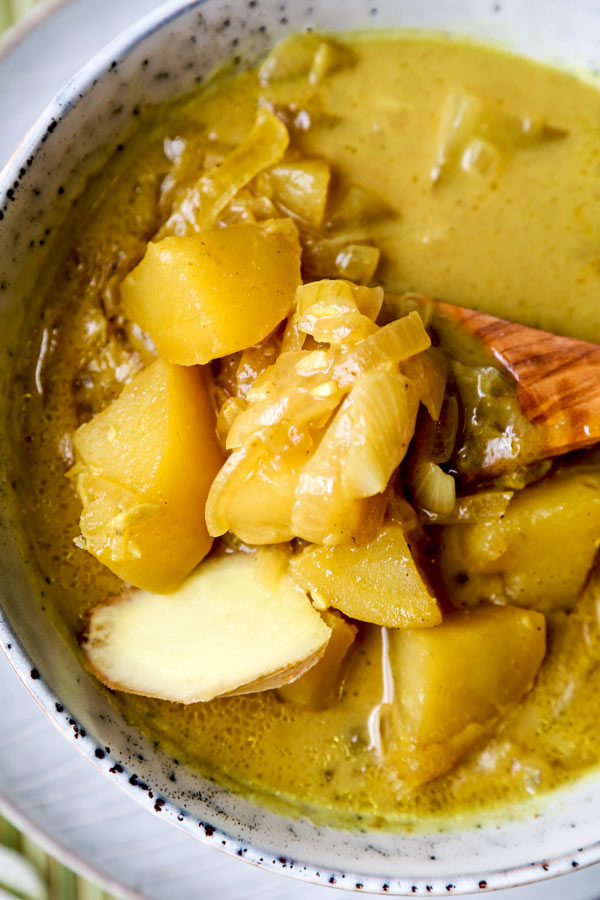 Thai Potato Curry (Vegan Recipe) - This is a quick and easy vegetarian curry loaded with potatoes and onions. It's an authentic Thai curry that's healthy and simple and only takes 30 minutes to make (from scratch). Yellow curry powder, soy sauce and coconut milk are the base of this vegan curry. Comforting, savory, delicious! #curryrecipes #healthyeating #thaifood #veganrecipes #vegetarianrecipes | pickledplum.com