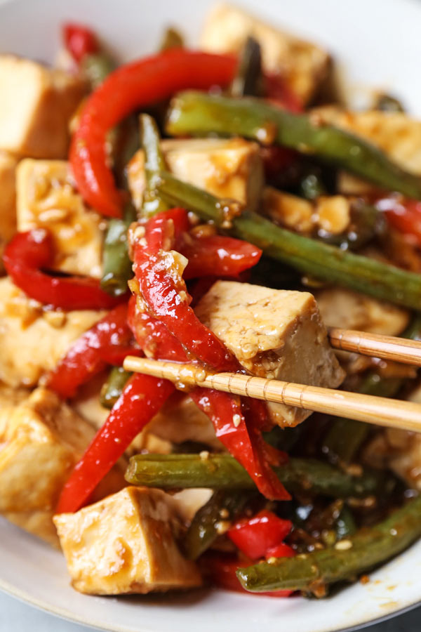 Asian Tofu Stir Fry Recipe - Easy, healthy vegetarian tofu stir fry with gooey sauce that's a little spicy. #tofurecipes #vegetarian #healthyrecipe #stirfry | pickledplum.com