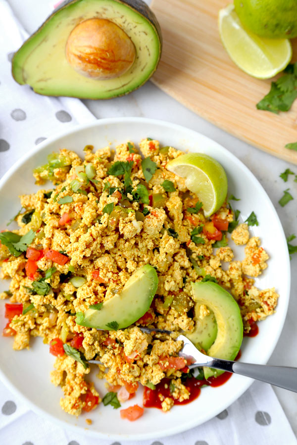 Mexican Style Tofu Scramble - An easy and delicious vegan breakfast recipe you can serve for dinner too! This Mexican Style Tofu Scramble Recipe could easily pass for a hearty plate of Huevos Rancheros! No turmeric used, we are going for Tex Mex flavors! #tofurecipes #tofuscramble #veganrecipes #veganbreakfast #meatlessmonday | pickledplum.com