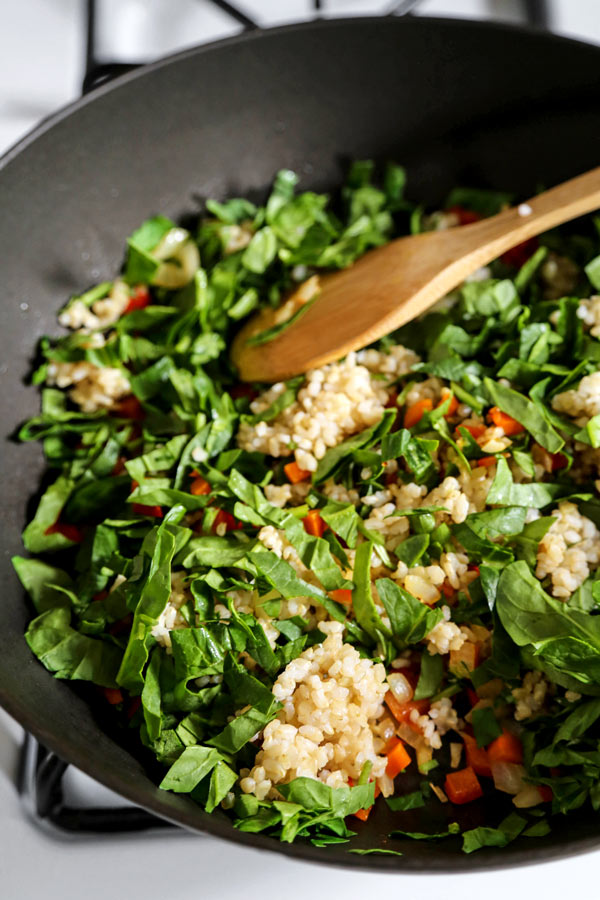 Vegan Fried Rice Recie - This is an easy and healthy vegan fried rice stir fry packed with veggies (no egg) and with traditional Chinese flavors. It's the best! #veganrecipes #vegetarianrecipes #plantbased #healthyeating #healthyrecipes | pickledplum.com
