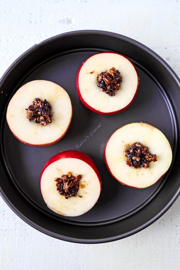 French Stuffed Baked Apples - A delicious dessert that hails from the French country side, these stuffed baked apples are sweet, tender and stuffed with nutritious ingredients. They are scrumptious! #dessertrecipes #christmasrecipes #vegetariandessert #healthydessert | pickledplum.com