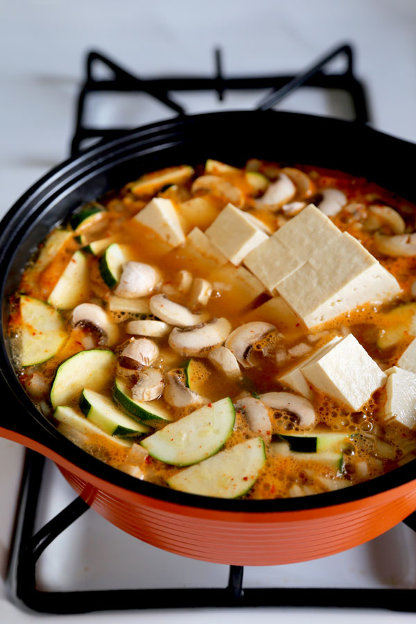 Vegetarian Doenj Jjigae - A delicious and comforting Korean soybean paste stew, ready in 25 minutes from start to finish. #koreanrecipes #hotpot #tofurecipes #vegetablesoup | pickledplum.com