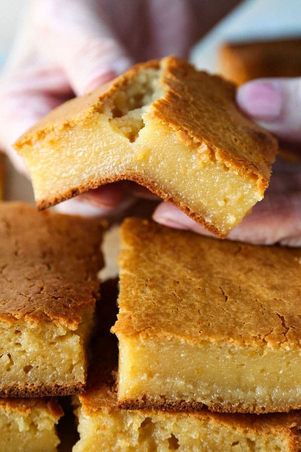 Healthier Hawaiian Butter Mochi Recipe - Hawaiian butter mochi is a sweet, chewy and stretchy dessert that's impossible to resist! I've substituted the butter for olive oil and some of the sugar for honey to add a floral note to this classic Hawaiian recipe.  #dessertrecipes #snacks #sweets | pickledplum.com
