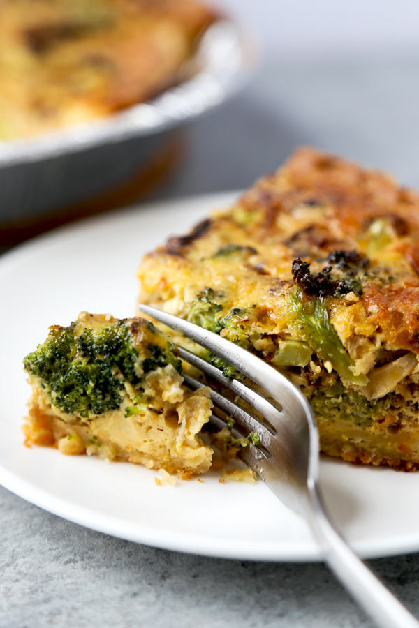 Making quiche at home is easier than you'd think! All you need is an oven and 7 ingredients to make this fluffy and savory Parmesan And Broccoli Quiche Recipe. Ready, set, bake! #frenchrecipe #homemadepie #healthybroccoliquiche | pickledplum.com