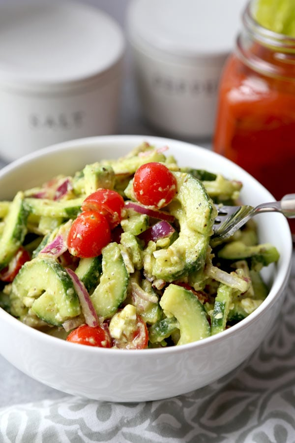 This bright and Creamy Cucumber Tomato Salad has the garden fresh taste of summer. Serve it at your Super Bowl party - or bring it to your next backyard cookout! #vegetariansalad #healthyrecipes #cucumbersalad #glutenfreesalad   pickledplum.com