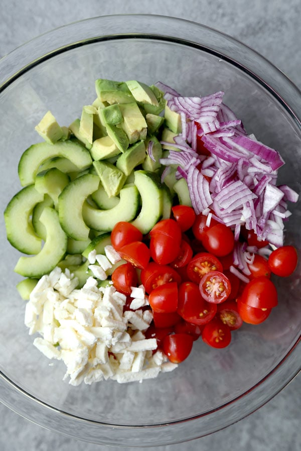 This bright and Creamy Cucumber Tomato Salad has the garden fresh taste of summer. Serve it at your Super Bowl party - or bring it to your next backyard cookout! #vegetariansalad #healthyrecipes #cucumbersalad #glutenfreesalad | pickledplum.com