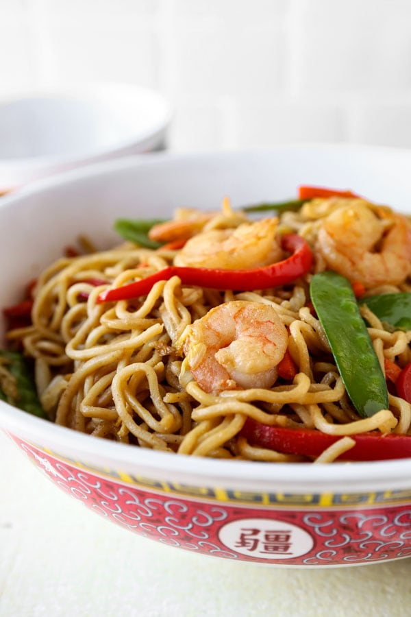 Shrimp lo mein is an easy Chinese recipe anyone can make at home! Use cabbage and your favorite veggies and stir fry them with egg noodles and an authentic lo mein sauce. Delicious! #pfchangs #stirfry #shrimprecipe #chinesefood | pickledplum.com
