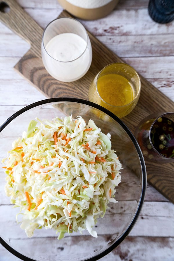 Coleslaw Dressing - Four easy and delicious homemade coleslaw dressing recipes. Vinegar, creamy, no mayo, Asian, with Greek yogurt, apple cider, there is one that's just right for you! #coleslaw #dressingrecipe #pioneerwoman #saladdressing #cabbage #slaw #vegan #nomayo #sidedish | pickledplum.com