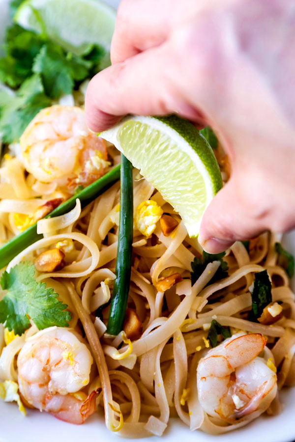 Classic Pad Thai - Ready for some stir fried noodle action? This Classic Pad Thai Recipe is a taste of Thailand. Best part: you can make these Thai noodles at home in 21 minutes! #thaifood #stirfry #asianrecipe #padthai | pickledplum.com