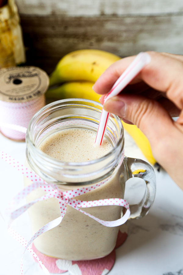 glass of peanut butter banana smoothie