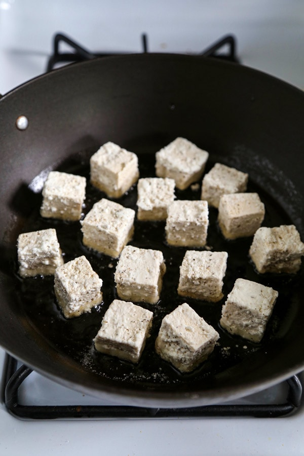 Dusted tofu in a pan