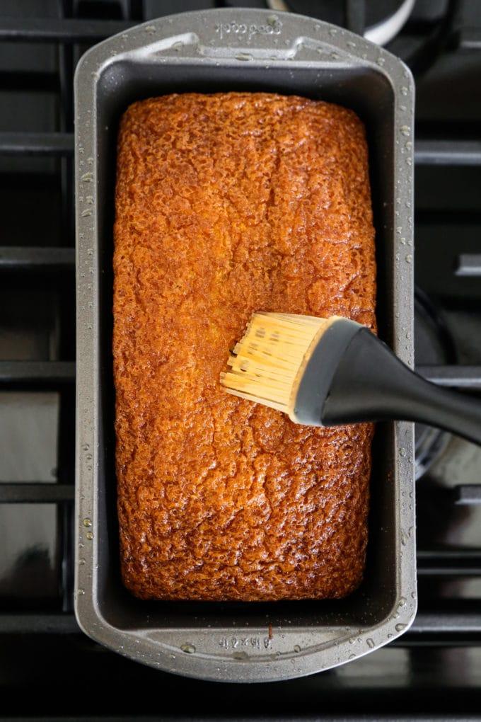 Brushing honey on castella cake