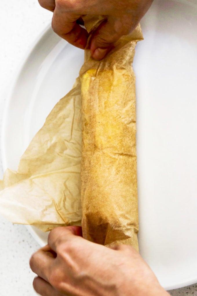 rolling tamagoyaki parchment paper