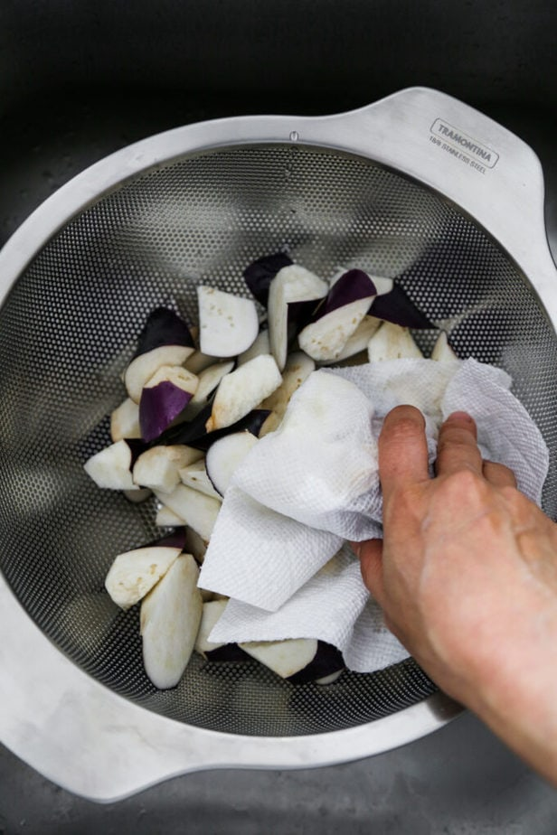 Patting dry Japanese eggplant